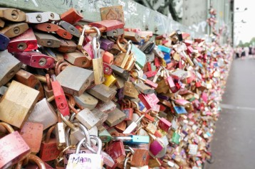Love locks fill every inch of the bridge