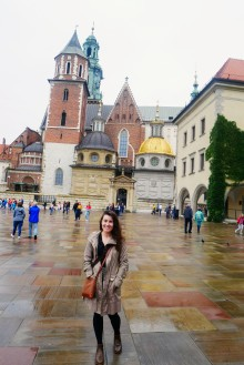 Kaitlan in front of the Wawel Cathedral
