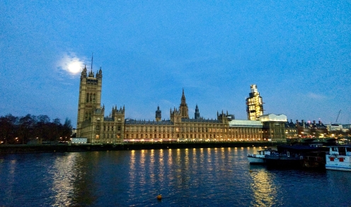 Views of Westminster Palace and a scaffold covered Big Ben