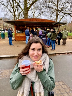 Kaitlan enjoying mulled wine and mince pie, which I learned aren't actually filled with meat (oops, silly American)