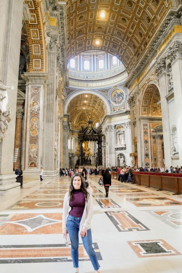 The massive and beautifully adorned interior of St. Peter's Square Basilica