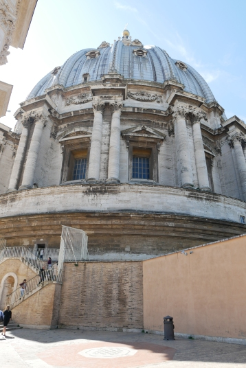 The dome of St. Peter's Square Basilica from the exterior (half-way up) + The interior tile-work near the top