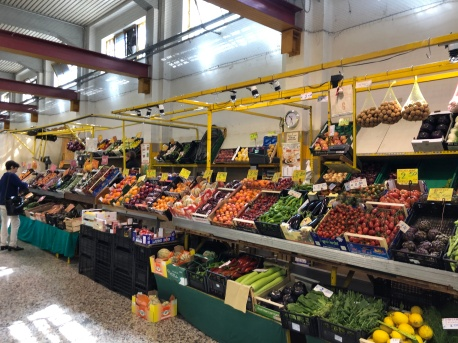 The stalls of fresh produce at Como Market Hall