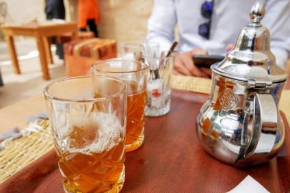 The coveted bubbles settled atop the mint tea are an indication of a good pour