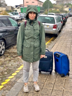 "Kaitlan's ""groutfit"" matching the mood of the weather in Porto"