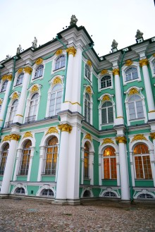 A close up view of the Winter Palace pale green exterior