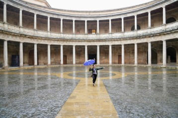 Singing in the rain at the Palace of Charles V inside the Alhambra