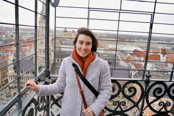 Kaitlan with a firm grip on the railing of the platform atop St. Peter's Church