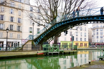 The Canal Saint-Martin with its locks and cast-iron footbridges