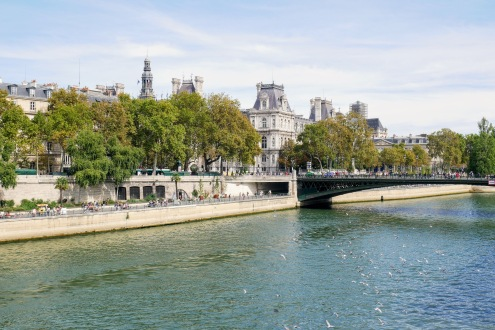 Walk alongside the left or right bank of the Seine River is a great way to experience the city