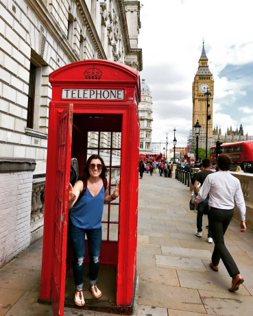 An iconic red phone booth with the Elizabeth Tower (prior to recent renovations) in the background